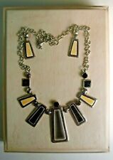 Vintage Enamel necklace and earrings with display case.