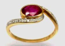 Anillos de joyería con gemas rojo de oro amarillo