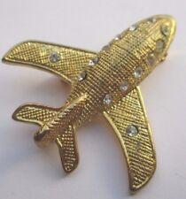 broche rétro bijou vintage avion couleur or finement gravé cristaux diamant 1957