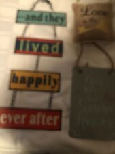 2 Metal Signs And One Small Hanging Cushion