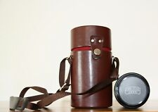 A CARL ZEISS JENA CAMERA LENS FOR THE OLYMPUS OM. IN ITS ORIGINAL CASE.
