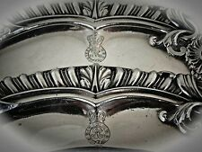 A Royal Pair Of English Sterling Silver Dinner Plates