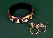 Leopard two-finger ring & carved skull bracelet