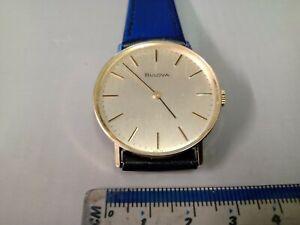 Gentlemans 9 carat yellow gold Bulova Mechanical watch on a leather strap.