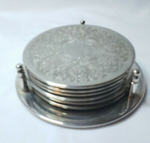"""7 Piece 3 5/8"""" Elegance Silverplated Rubber Bottom Coasters with Nesting Stand"""