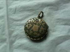 Victorian gold round engraved double locket