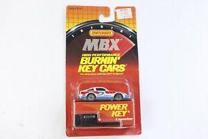 Matchbox MBX Burnin' Key Car White Blue Red Nissan 300 ZX On Card