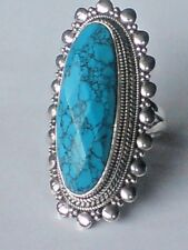 STERLING SILVER 45mm.x 20mm.RING with a TURQUOISE FACETED STONE UK.L £39.95 NWT