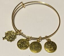Adjustable Bangle Bracelet Gold Tone 4 charms -- 1 tree diecut and 3 sold charms