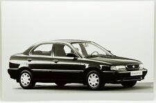 Fotografia Originale - Suzuki Baleno 1,6 GLX 16V Sedan,4 -TP/P cm11,6 x 17,5