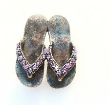 BROOCH sneakers, slates sandals marked with a star