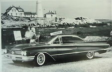 "12 By 18"" Black & White Picture 1960 Buick Invicta 2 door hardtop #2 light house"