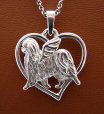 Sterling Silver Japanese Chin Angel Pendant On A Free Form Heart Pendant