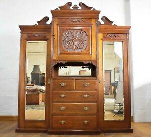 Antique Victorian carved breakfront combination triple wardrobe