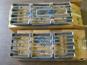 NOS OEM Ford 1968 Galaxie 500 XL LTD Headlight Door Grille Trim Bezels Pair