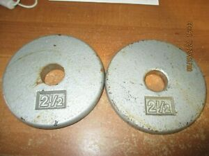 TWO     2 1/2 LB  Weight Plates