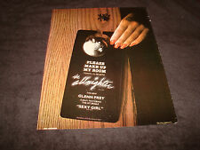 Glenn Frey 1984 promo ad with reflection on doorknob for 'Sexy Girl', The Eagles