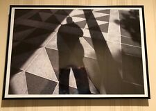 Framed Black and White Photo of Photographer's Shadow at Exterior of Building