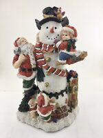 Santa, Snowman, And Children Figurine Approximately 11 inches Christmas Decor