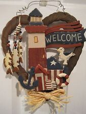 Wooden, heart-shaped, Nautical themed welcome sign with lighthouse, anchor, more