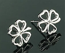 lovely silver coloured cutout flower stud earrings