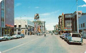 Casper WY Center Street Rialto Movie Theatre Old Cars Storefronts Postcard
