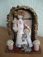 """Laura Dunn Studio Pottery Figurine """"Lady with baby, child and cat in porch"""""""