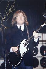 Original hand signed mounted photo of Rick Parfitt 11.9 x 8 in by Mel Longhurst