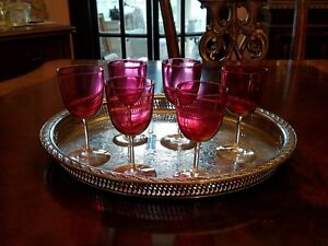 6 Cranberry Wine glasses, clear stem and foot, antique?