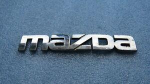 MAZDA 323 - Embleme Heckklappe Logo BADGE EMBLEM // GE5A51711