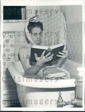 1941 University of Kansas Student Takes Ice Bath While Studying Press Photo