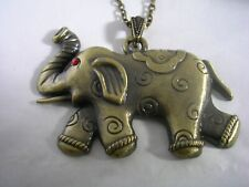 Elephant Pendant In Antiqued Brass With A Ruby Set In The Eye Comes With A Chain