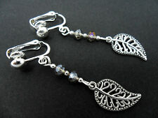 A PAIR OF  TIBETAN SILVER DANGLY LEAF & CHAMPAGNE CRYSTAL CLIP ON EARRINGS. NEW.
