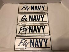 Vintage Assortment Of Navy License Plate Toppers