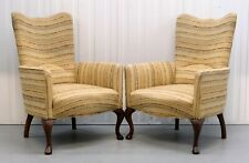PAIR OF WINGBACK ARMCHAIRS ON PLAIN CABRIOLE LEGS,FLARED ARMS & ARCHING BACKREST