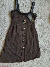 Brown lined dress. Knitted chocolate brown with white speckles. Gentle puff