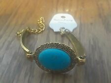 6 Inches w/ 2.5 Inch Extender Women's Gold Tone & Turquoise Oval Bracelet