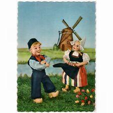 AK Puppen, Dolls, aus Holland vor einer Windmühle