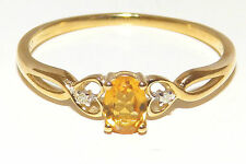 9 Carat Oval Yellow Gold Three-Stone Fine Diamond Rings