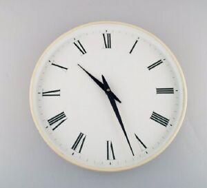 Henning Koppel for Georg Jensen. White plastic wall clock. 1960/70's