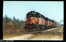 "Milwaukee Road  GP-40 #2016 leads the ""Ford Freight""  Wisconsin Dells postcard"