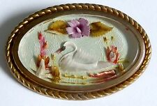 A VINTAGE 1950s REVERSE CARVED LUCITE BROOCH WITH SWAN & FLOWERS SCENE