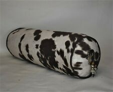 western farmhouse cowhide bolster pillow with conchos in brown black beige