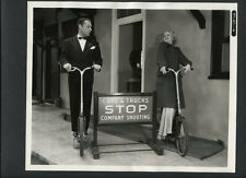 CLAIRE TREVOR + BRIAN DONLEVY RIDE STATIONARY BICYCLES - 1936 EXC COND CANDID