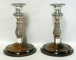 Pair of antique Old Sheffield Plate silver-plated candlesticks with wooden bases