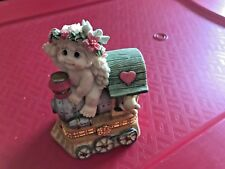Dreamsicle Cherub Riding On A Train Bottom Opens Like A Chest 1997 4 1/2""