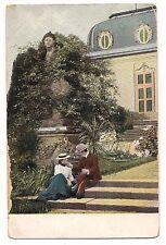 COURTING MAN & WOMAN Romance Overgrown Plants Statue Fancy Building Postcard
