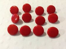 12 Red coloured Old/vintage glass buttons.