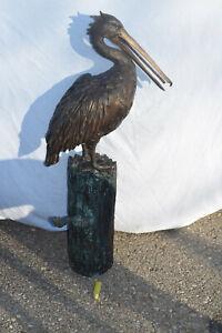 Bronze-Pelikan auf Baumstamm, 2-farbige Antikpatina, ca.35kg, 108cm