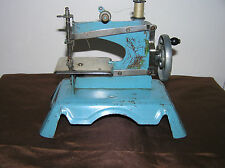 ANTIQUE FRENCH TIN TOY SEWING MACHINE.